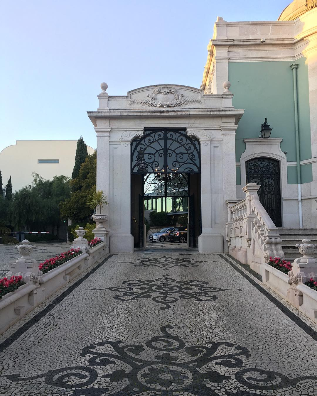 Sunset over the entrance/driveway of the Pestana Palace i...