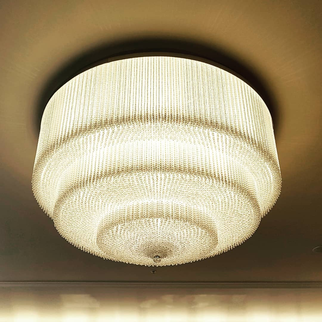 Large scale concentric glamour in a light fitting of gran...