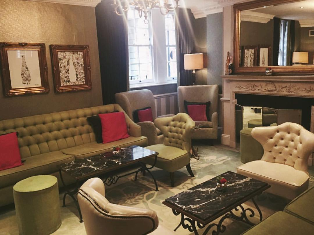 This exquisite interior is a lounge room in Dukes London ...