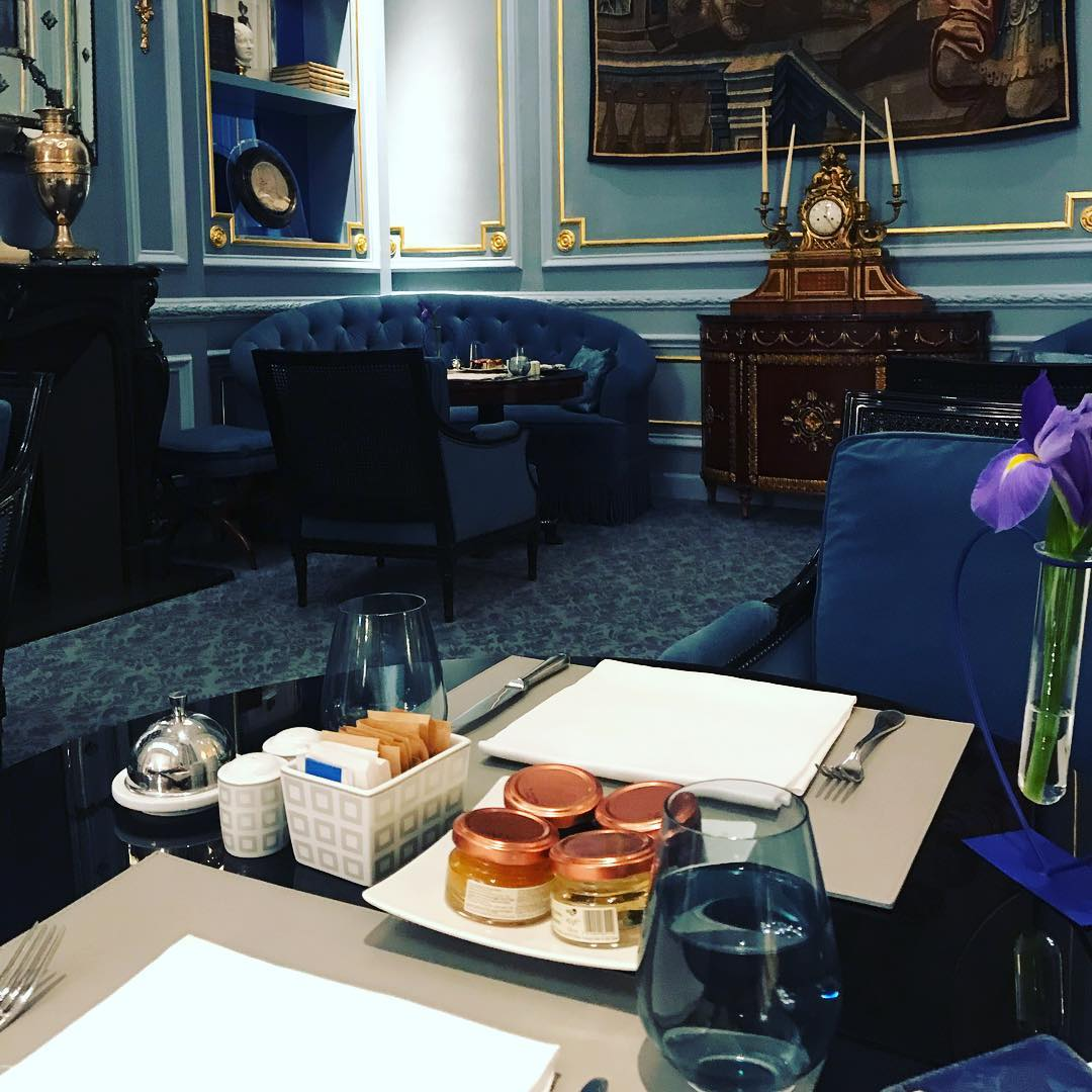 Enjoying my breakfast in a beautiful blue room